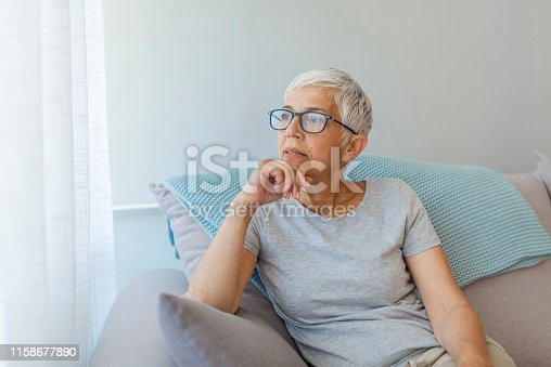 1044149594 istock photo Middle aged mature grey haired woman 1158677890