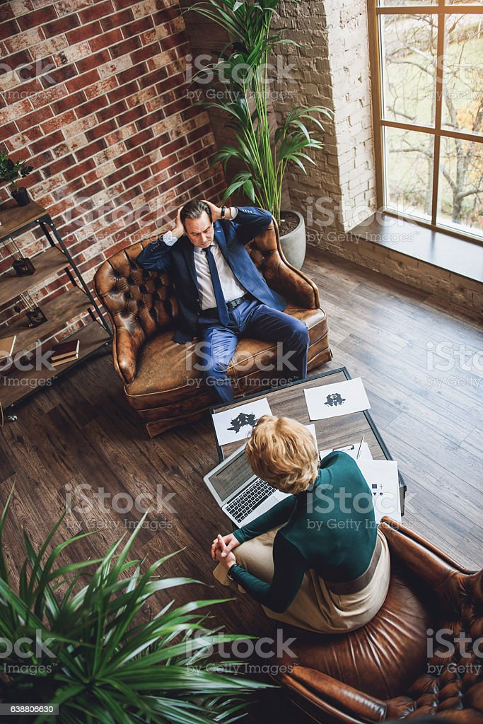 Middle aged serious man is office of psychologist stock photo