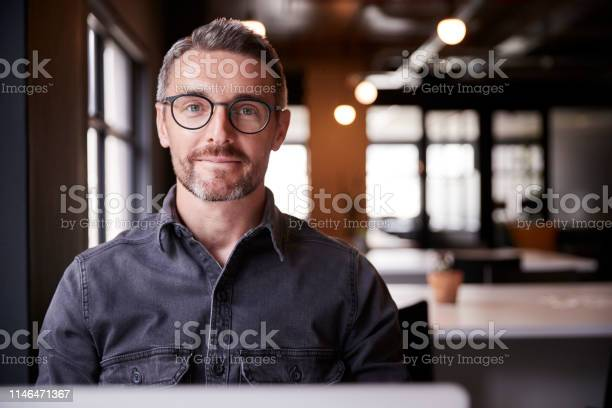Middle aged white male creative sitting in an office smiling to head picture id1146471367?b=1&k=6&m=1146471367&s=612x612&h= etk ye8mk4pc3 3xi0 njs1yrowy1yrt uys5b77xo=