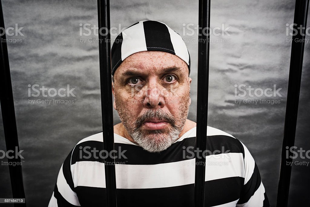 Middle aged white man in jail stock photo