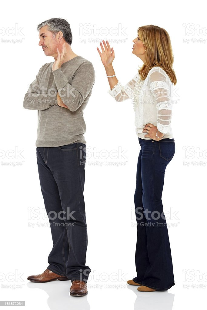 Middle aged woman arguing with her husband royalty-free stock photo