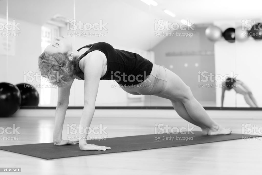 Middle aged woman doing yoga stock photo