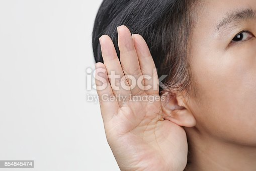 istock Middle aged woman hearing loss , Hard of hearing 854845474
