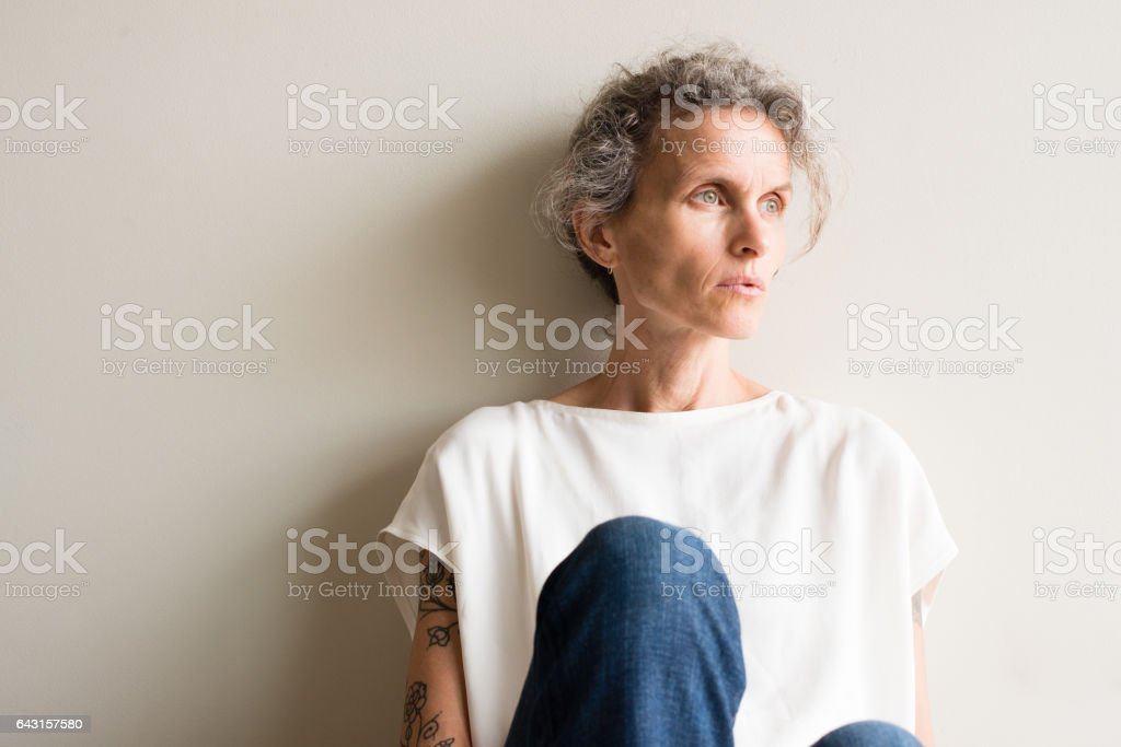 Middle aged woman looking pensive stock photo