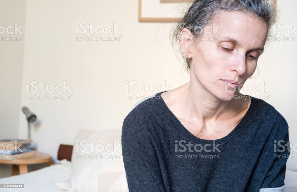 Middle aged woman looking sad stock photo