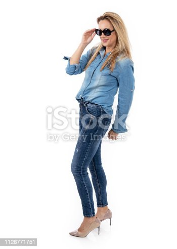 istock Middle aged woman posing as a model for clothes 1126771751