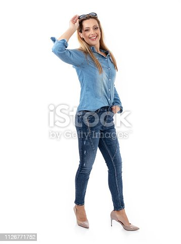 istock Middle aged woman posing as a model for clothes 1126771752
