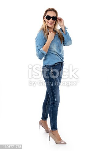 istock Middle aged woman posing as a model for clothes 1126771758