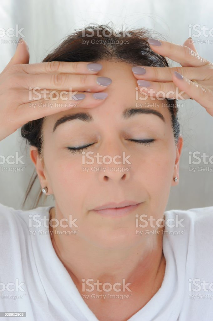 middle aged woman self massage stock photo
