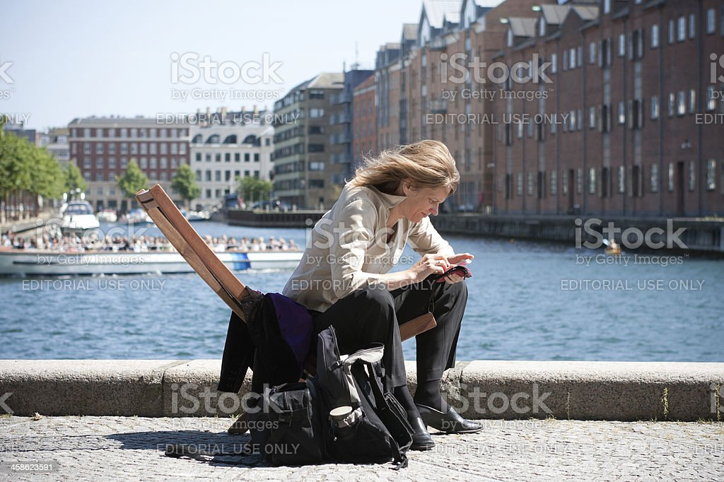MIddle aged woman sitting down stock photo