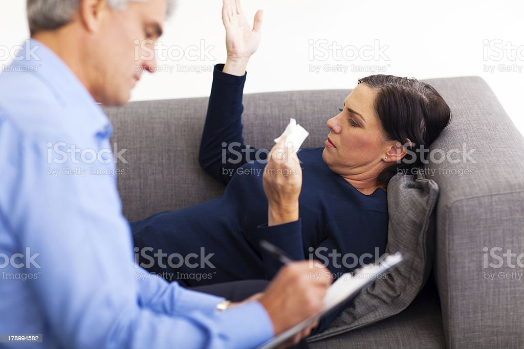 middle aged woman talking to her therapist royalty-free stock photo