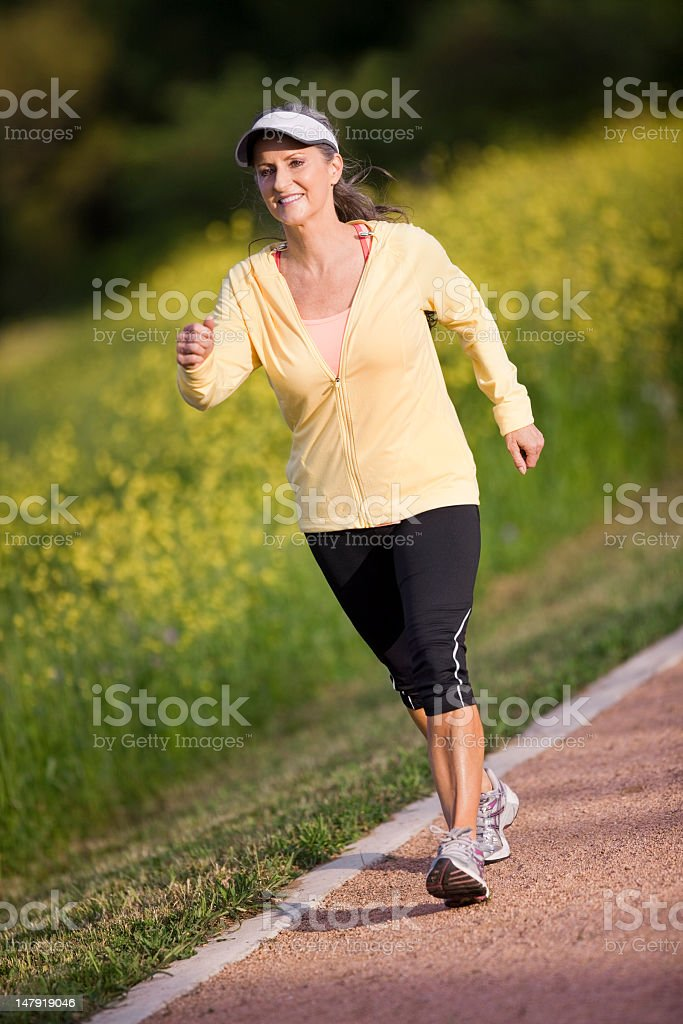 Middle Aged Woman Walking On Trail royalty-free stock photo