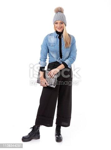 636803682 istock photo Middle aged woman wanna be fashion model 1128344251