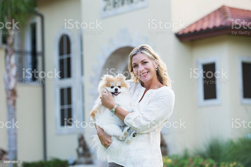 Middle aged woman with her pet pomeranian stock photo