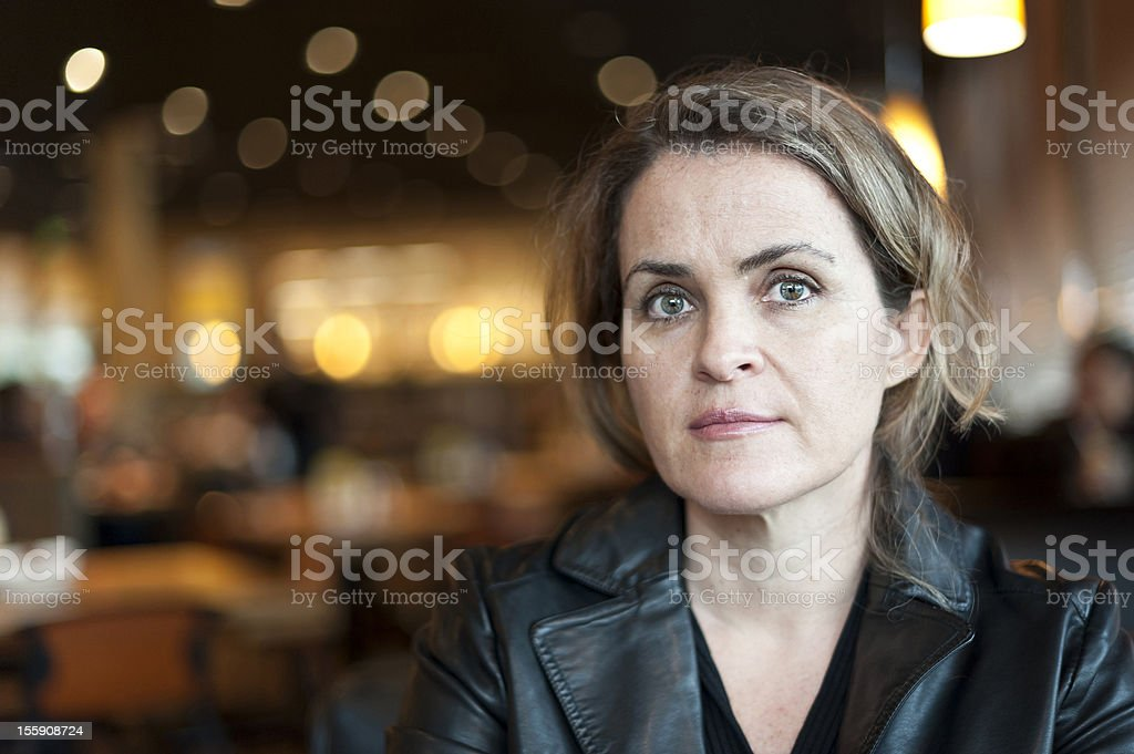 A middle aged women who is concerned stock photo