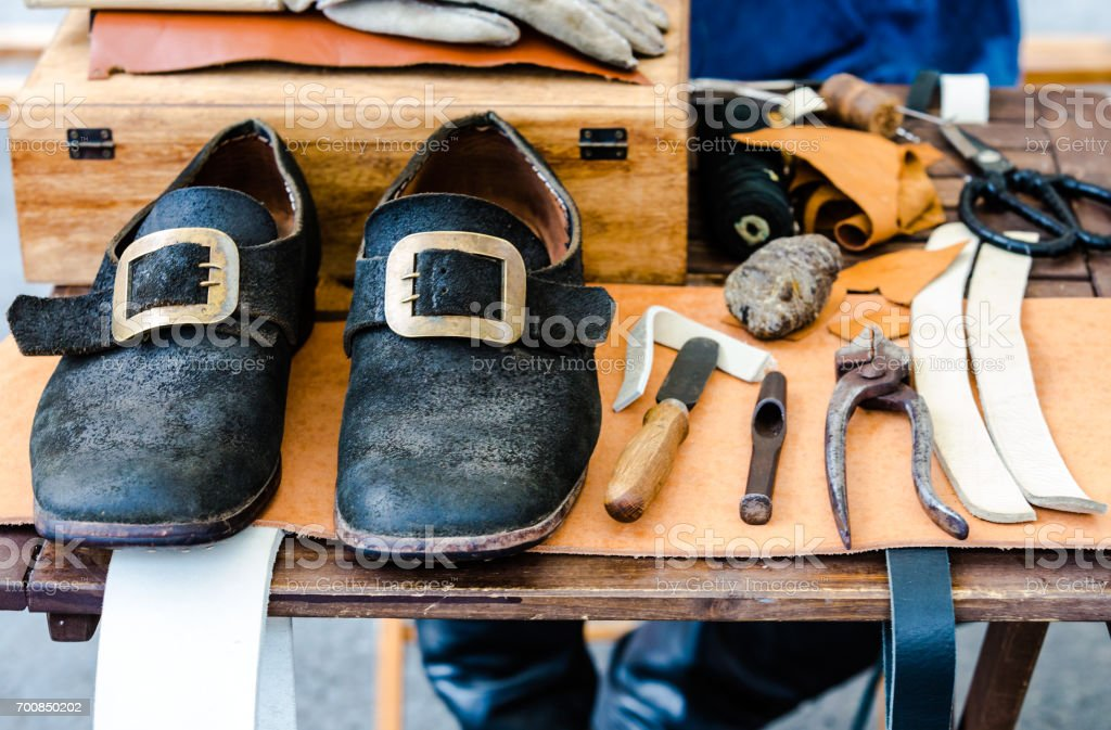 Middle Agility Shoes in Workshop with tools of shoemaker stock photo