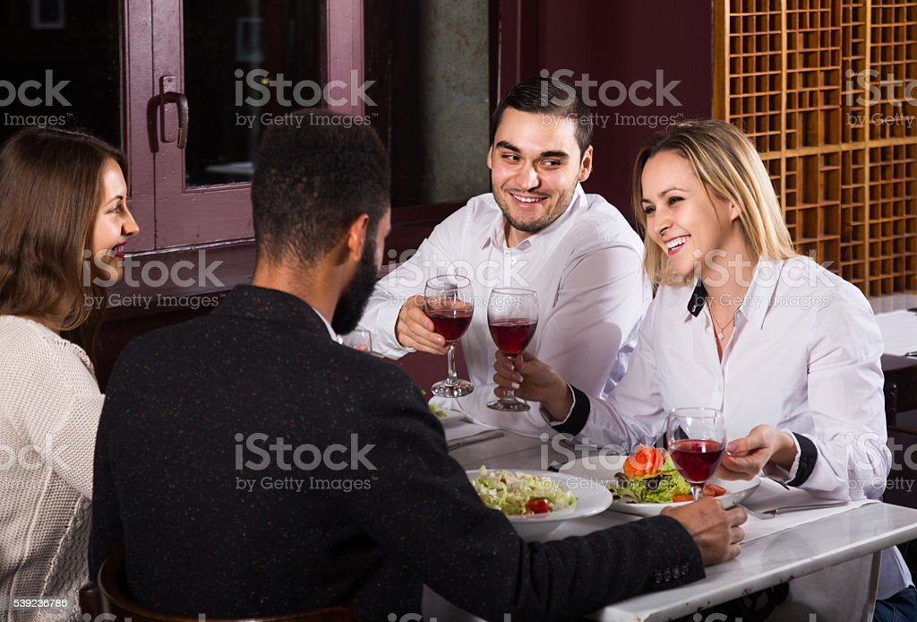 middle class people enjoying food in cafe and talking royalty-free stock photo