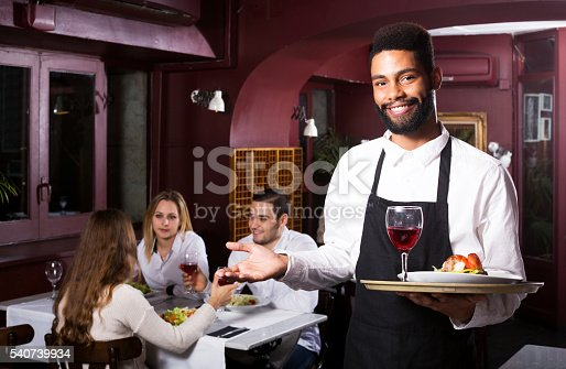 istock Middle class restaurant and cheerful waiter 540739934