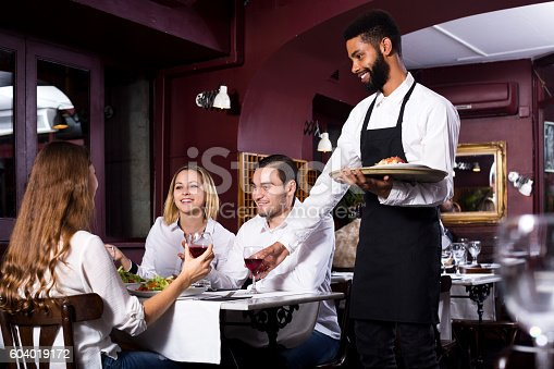 istock Middle class restaurant and cheerful waiter 604019172