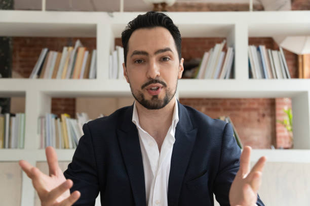 Middle east appearance businessman makes videocall look at camera talking stock photo