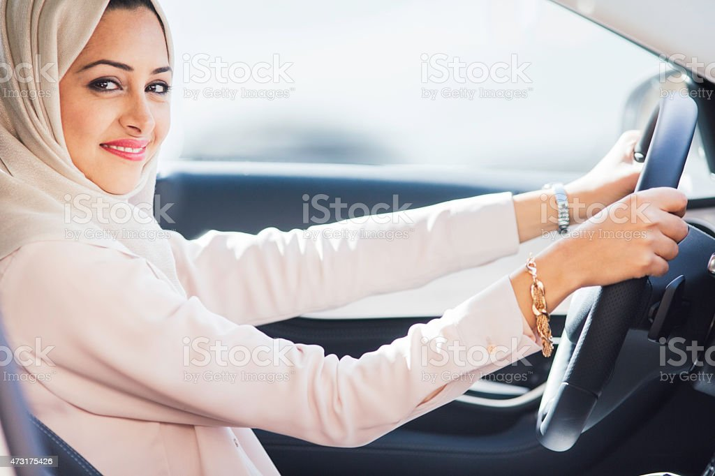 Middle easter woman driving a luxury car in Dubai stock photo