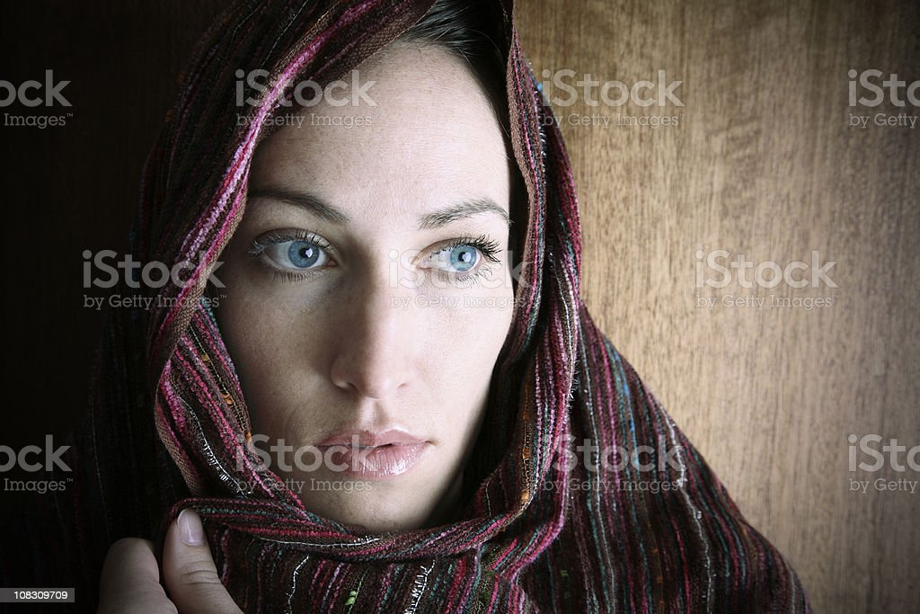 Middle Eastern Adult Woman Covered With Head Covering stock photo