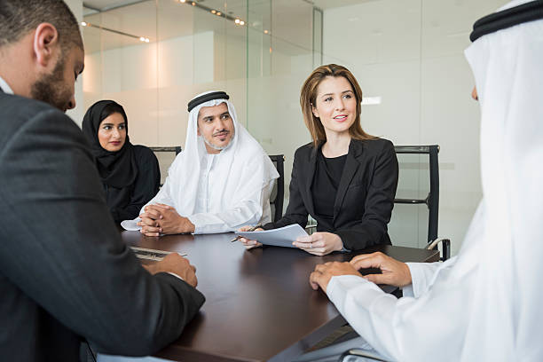 Middle Eastern business people in meeting at office stock photo