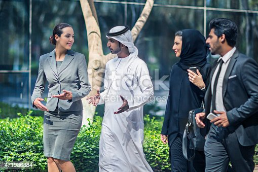 471250190istockphoto Middle Eastern business people talking in the street 471986384