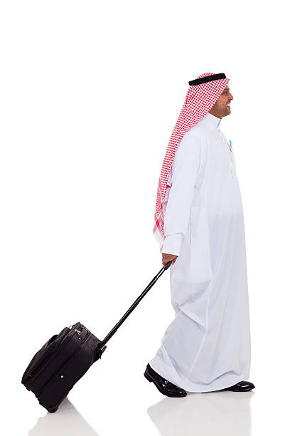 middle eastern business traveller stock photo