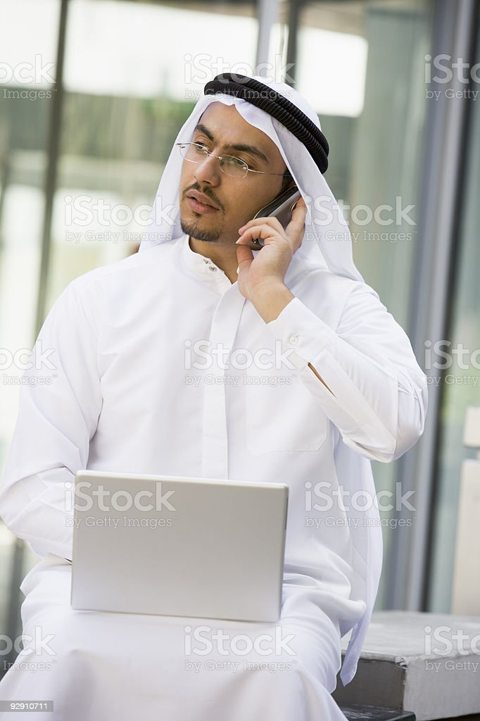 Middle Eastern businessman sitting with laptop royalty-free stock photo