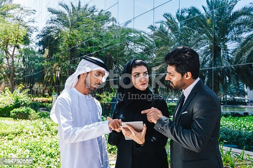 471250190istockphoto Middle Eastern Businessmen and Businesswoman working with Digital Tablet Outdoor 494790558