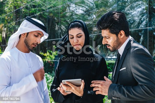 471250190istockphoto Middle Eastern Businessmen and Businesswoman working with Digital Tablet Outdoor 494790794
