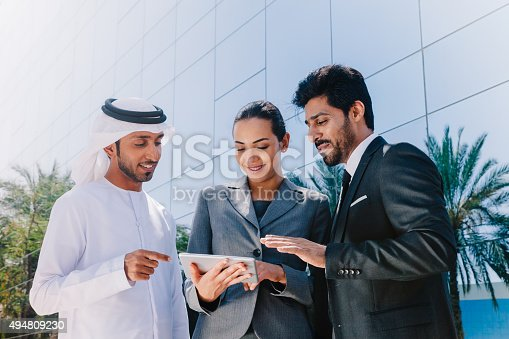 471250190istockphoto Middle Eastern Businessmen and Businesswoman working with Digital Tablet Outdoor 494809230