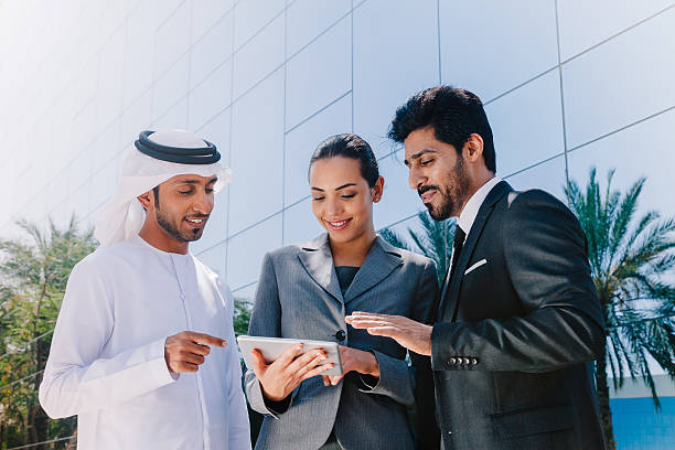 Middle Eastern Businessmen and Businesswoman working with Digital Tablet Outdoor stock photo