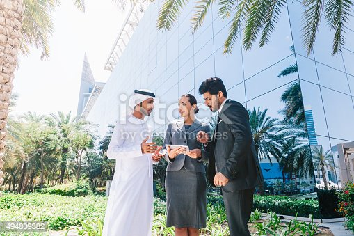 471250190istockphoto Middle Eastern Businessmen and Businesswoman working with Digital Tablet Outdoor 494809382