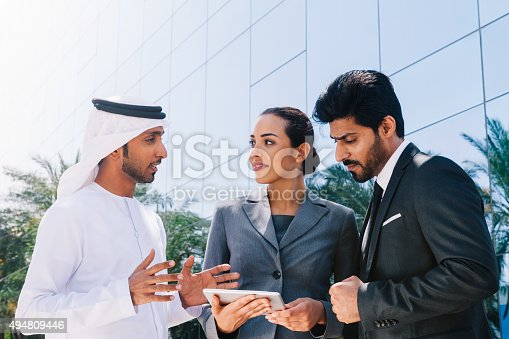 471250190istockphoto Middle Eastern Businessmen and Businesswoman working with Digital Tablet Outdoor 494809446