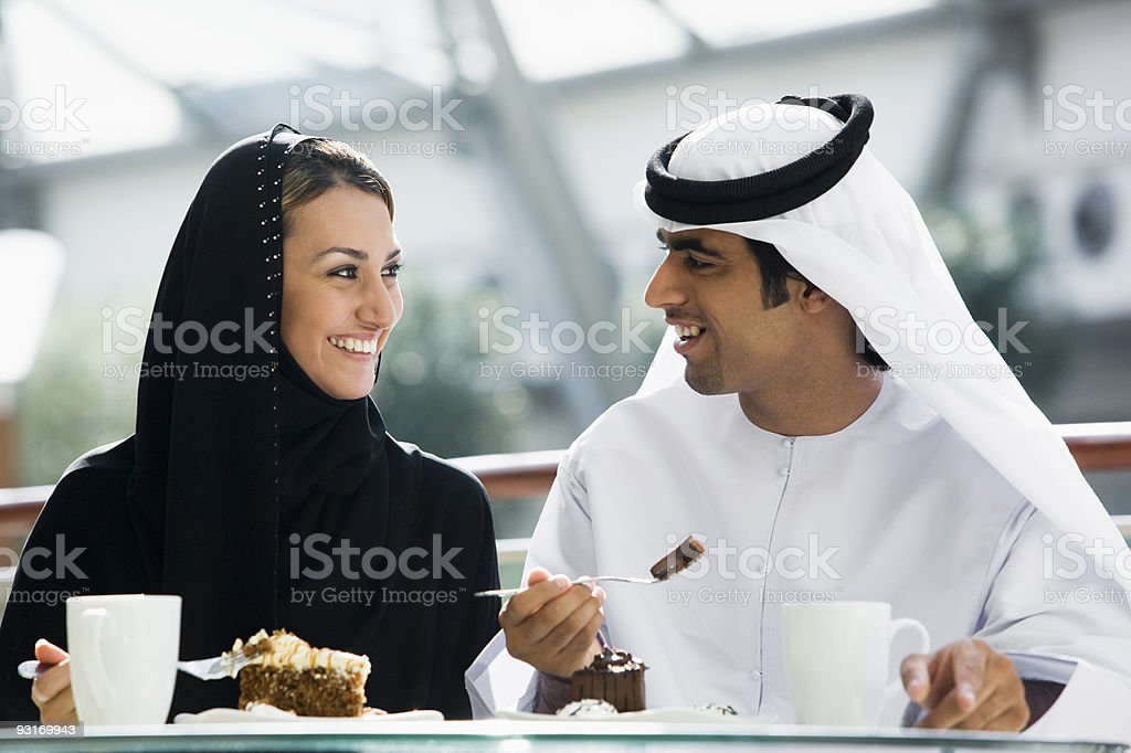 Middle Eastern couple enjoying a meal stock photo