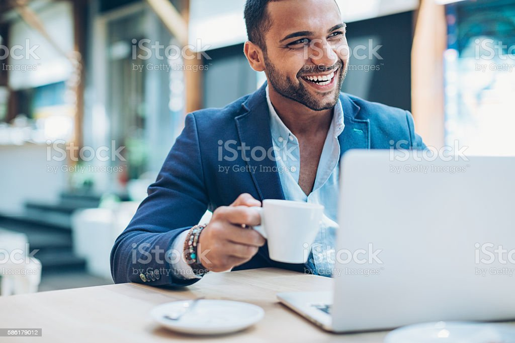 Middle Eastern ethnicity businessman in cafe stock photo