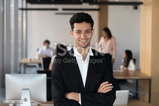 istock Middle eastern ethnicity businessman in suit posing in coworking 1092087700