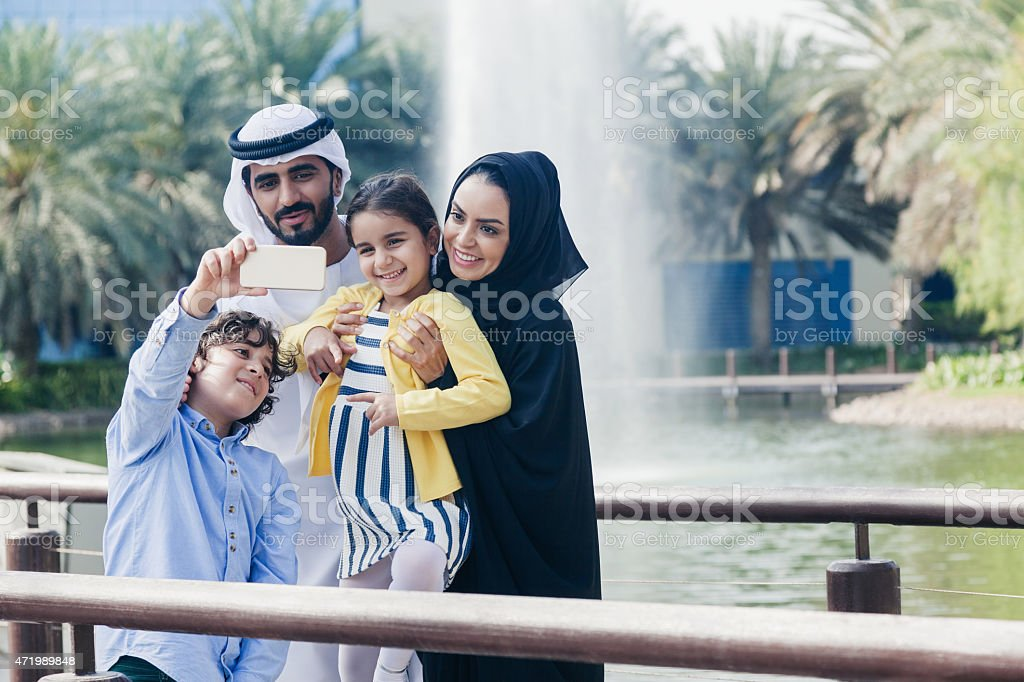 Middle eastern family taking a photo stock photo