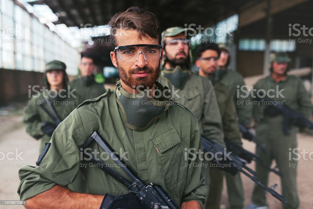 Middle Eastern leader with soldiers ready to attack stock photo