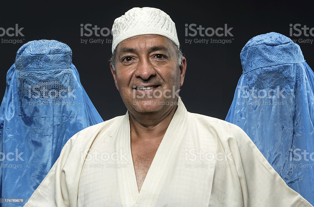 Middle eastern man and his wives stock photo