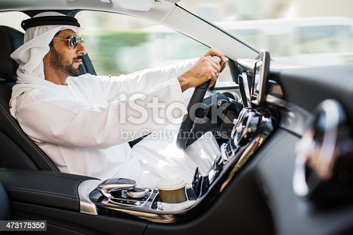 istock Middle eastern man driving a luxury car in Dubai 473175350