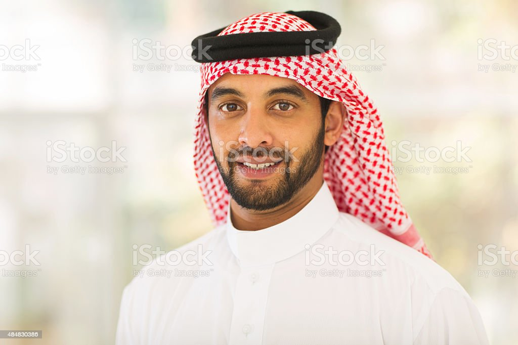 middle eastern man looking at the camera stock photo