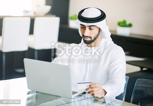 istock Middle Eastern Man Shopping Online 491352068