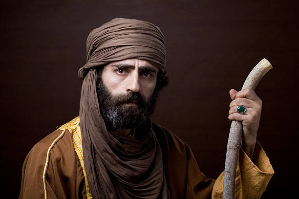 Middle eastern man with headscarf in traditional headscarf and clothing stock photo