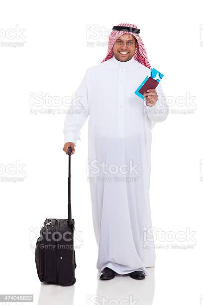 Middle eastern man with luggage and air ticket picture id474048632?b=1&k=6&m=474048632&s=612x612&h=esquhxx c qbyan1mftnasp5nolmscu0y9pzyasldva=