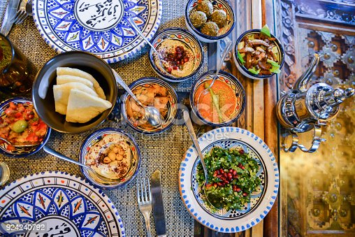 istock Middle eastern or arabic dishes and assorted meze, concrete rustic background 924240792