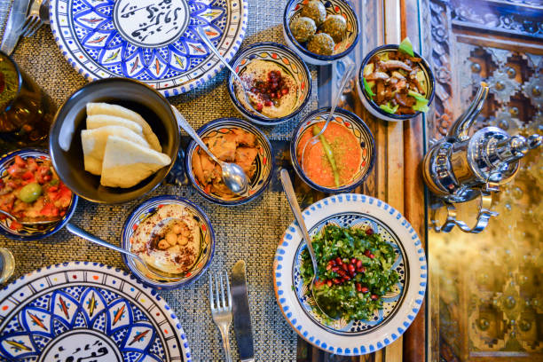 Middle eastern or arabic dishes and assorted meze, concrete rustic background Middle eastern or arabic dishes and assorted meze, concrete rustic background. Meat kebab, falafel, baba ghanoush, muhammara, hummus, sambusak, rice, tahini, kibbeh, pita Halal food Lebanese cuisine east africa stock pictures, royalty-free photos & images