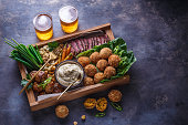 istock Middle eastern party food: falafel, babaghanoush, potatoes, beef, green veggies. 1179124888